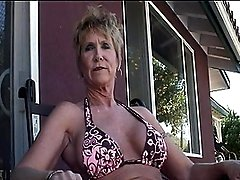 Mature Honey Jizzed On Huge Fake Tits