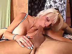 Blonde aged mature in white stockings does blowjob