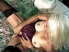Nice blonde granny teases her pussy