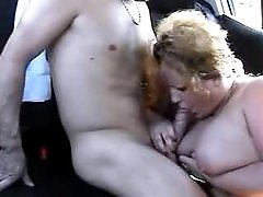 Plump mom titfucks and sucks in car