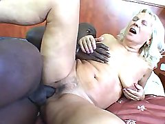 Granny blows big black cock n has fuck from behind