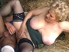 Blonde granny in stockings has hot  sex on hayloft