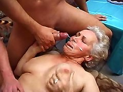 Depraved granny gets facial after hot fuck in orgy
