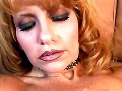 Hot mature in stockings masturbates